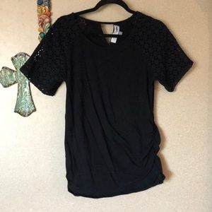 Eyelet sleeved top with triangle cutout in back